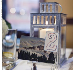 Galvanized candle lanterns warmed up each table, with custom-designed table numbers featuring elements of the mountainous surroundings.