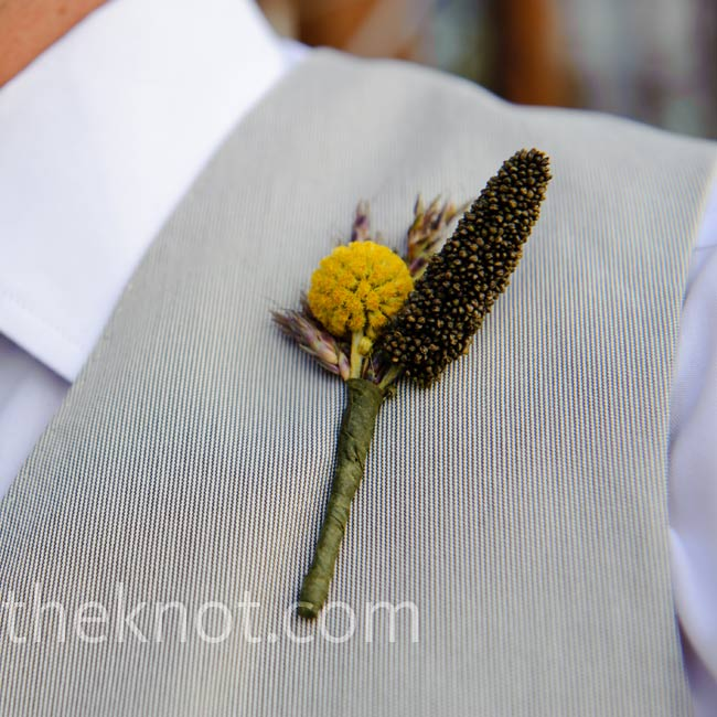 A stem of yellow craspedia added a bright pop of color against the men's gray vests.