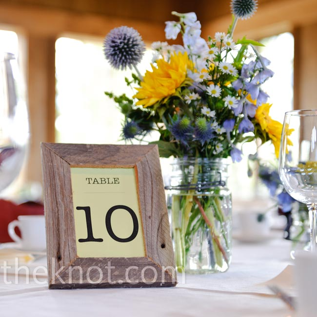 The couple found rustic wooden frames on eBay and printed each table number on pale-yellow paper.
