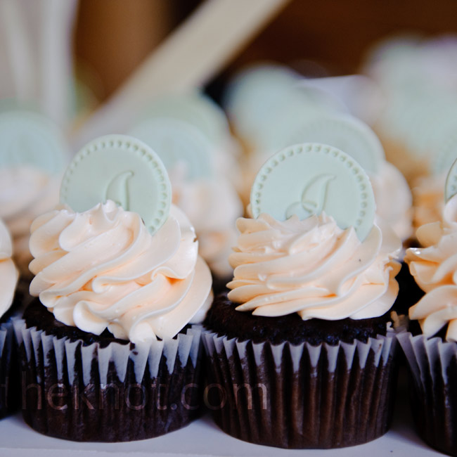 Rather than traditional cake, the bride and groom served delicious cupcakes with monogrammed sugar discs.