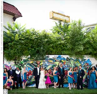 Each bridesmaid wore a teal dress in the style of her choice, while the flower girl (Emmanuel's daughter) stood out in a fuchsia frock.