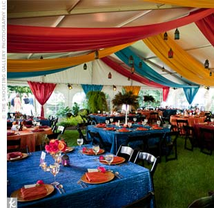 Burnt-orange, gold and teal linens were draped from the ceiling, and lanterns hung from the tent and the surrounding trees.