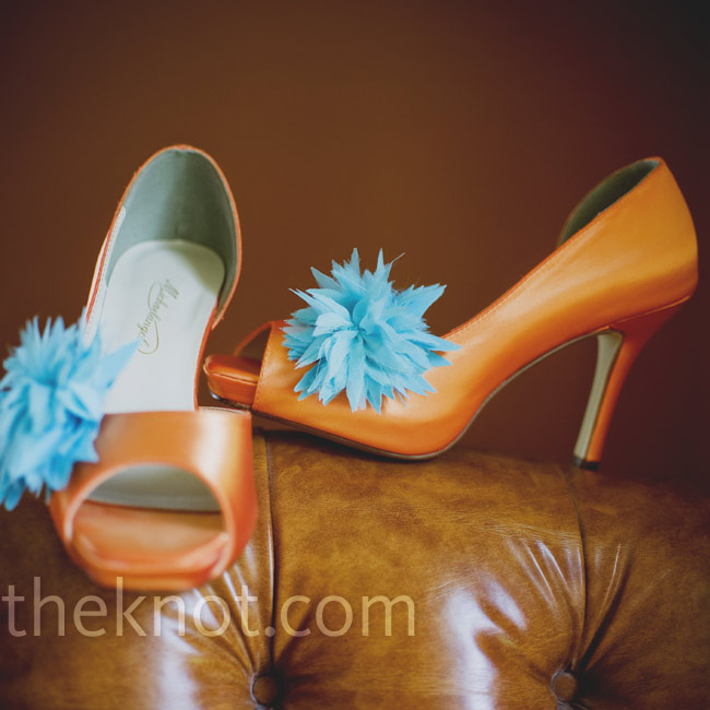 Aqua shoe clips added color and character to Meghan's orange pumps.