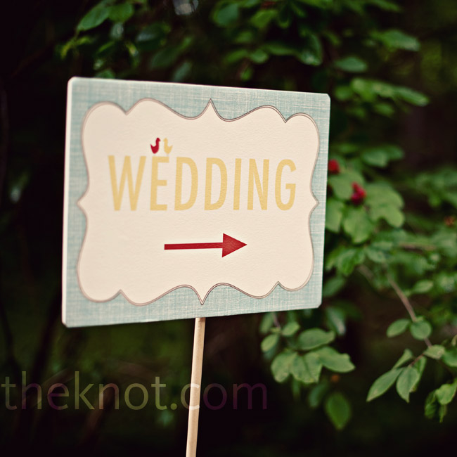 A simple sign directed guests to the ceremony.