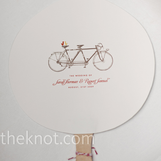With her bridesmaids' help, Sarah also made the paper-fan programs, which featured the same tandem bicycle illustration as the invitations.