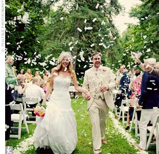 Guests tossed white, eco-friendly (it dissolves in water) confetti at the couple as they walked down the aisle as newlyweds.