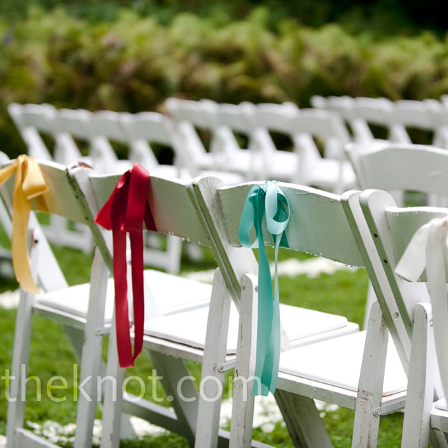 A single ribbon in yellow, red, aqua or white hung from the back of each chair in the last row.
