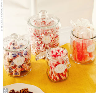 Guests took home treats from a candy buffet. Sarah labeled goodie bags and jars with stickers.