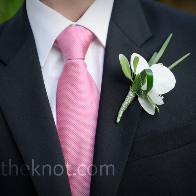 A phalaenopsis orchid with lily grass loops matched Danielle's bouquet.