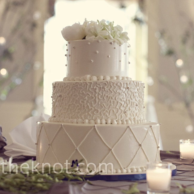 The buttercream cake's three tiers each featured a different design.