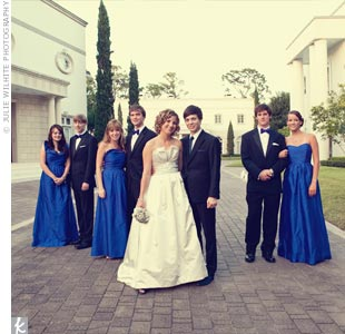 Each bridesmaid chose her own blue, floor-length dress by LulaKate.