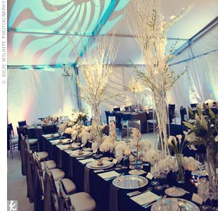 To play up the formal blue, white and silver color palette, tree-like silver arrangements draped with white flowers and crystals decorated the room.