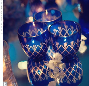 Votives in blue holders were scattered on the tables.