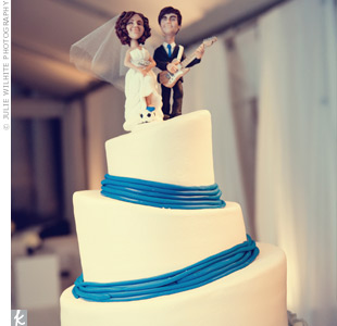 Asymmetrical tiers, blue icing and a quirky topper added a modern flair to the cake.