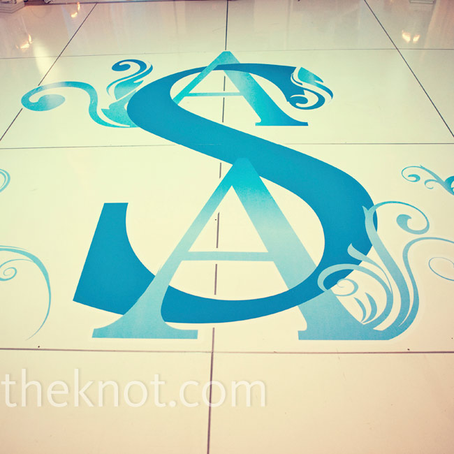 A cobalt-blue decal of the couple's monogram gave the dance floor a personal touch.