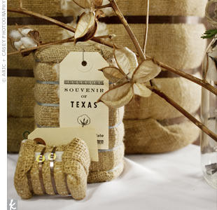 Old-fashioned miniature cotton bales and cotton branches decorated the sign-in table and tied into the wedding's rustic theme.