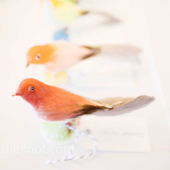 Mini manila tags were tied to brightly colored birds.