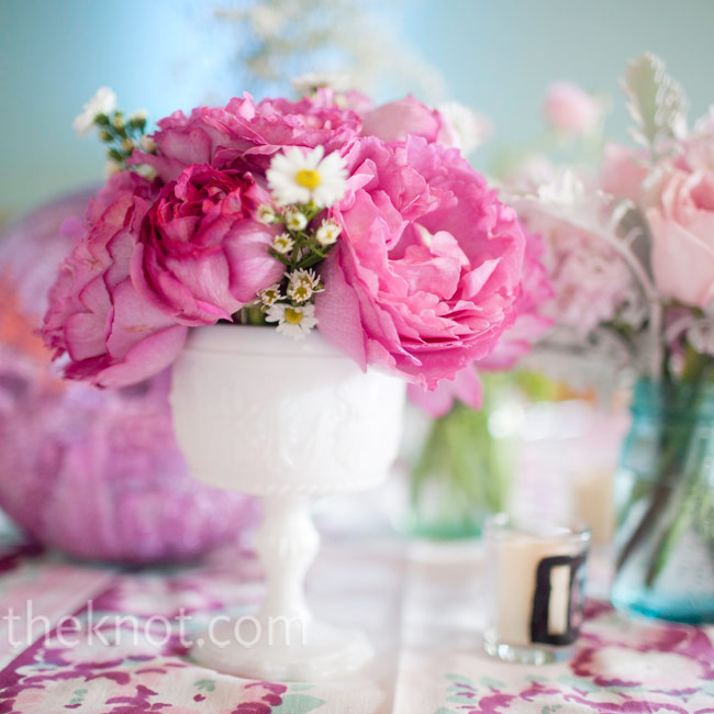 A mix of peonies, roses and asters in antique vases and jars looked eclectic on the tables.