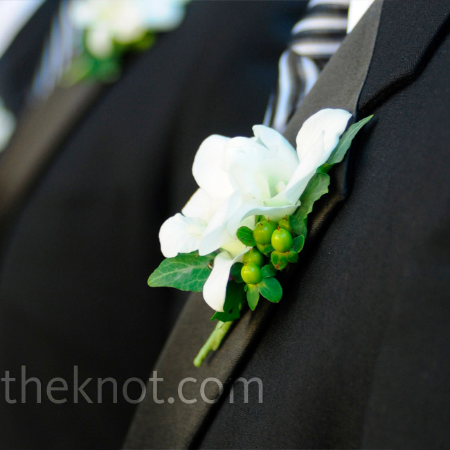 The groomsmen wore white bouts for a classic look.