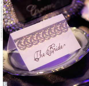 Instead of traditional escort cards, calligraphed cards reserved tables for family.
