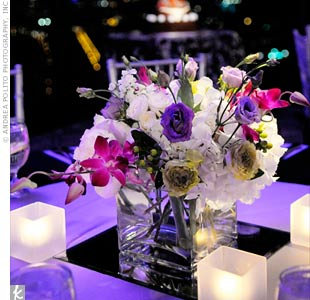 Smaller sets of purple and white flowers on mirrored platforms topped the tables during the cocktail hour.