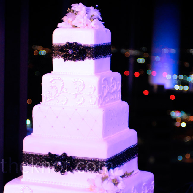 The six-tiered buttercream cake was coated with a pearlized spray for a little bit of shimmer.