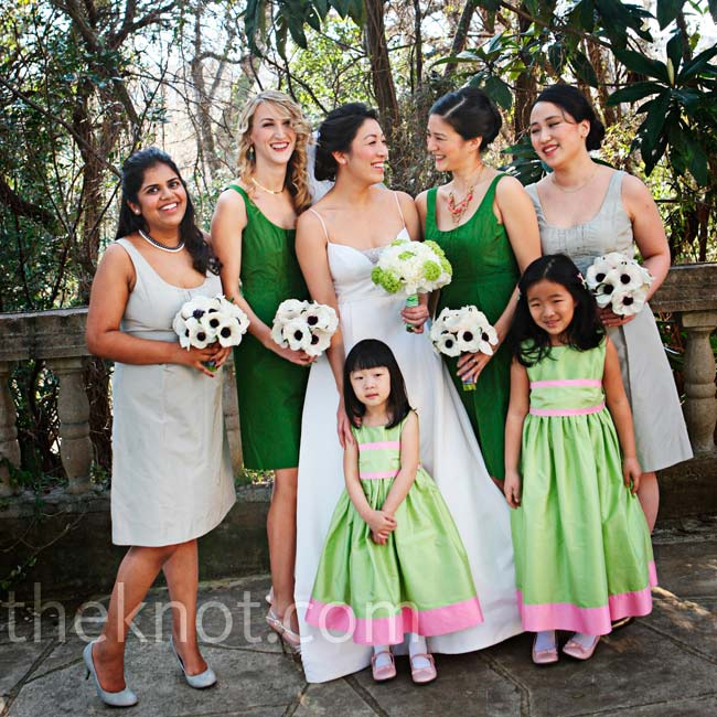 The bridesmaids wore silver and green dresses, while the flower girls coordinated in light green and pink.