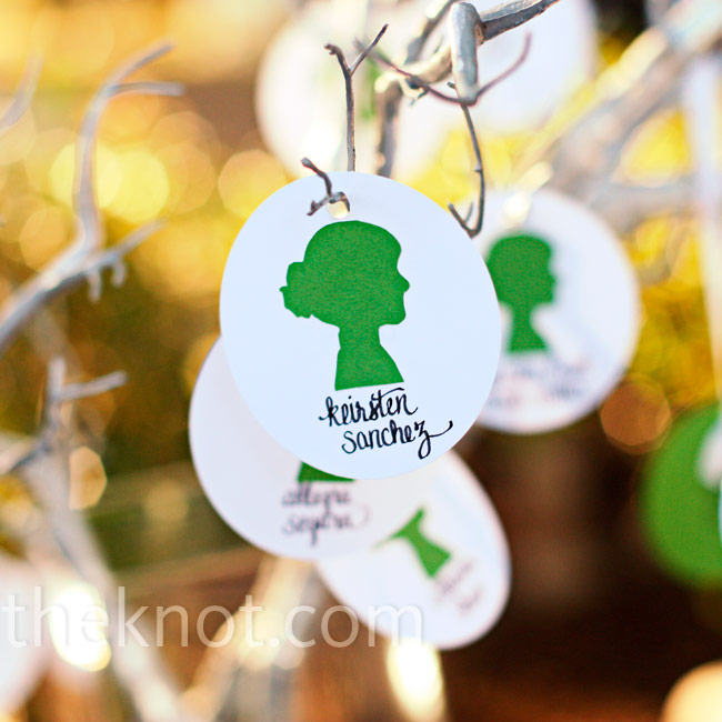 Melanie and Joe hung hand-cut card stock circles with color-coded silhouettes from manzanita branches.