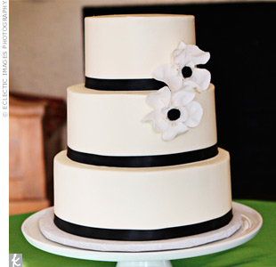 Black ribbon and white sugar anemones decorated the buttercream cake.