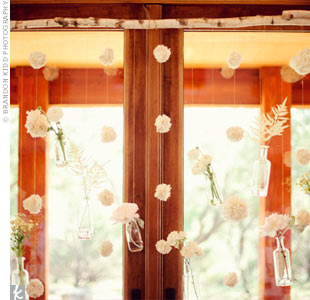 Libby created a hanging installation of glass vases and fabric garlands to mark the altar space without blocking the view.