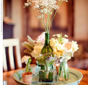 Groups of blooms such as garden roses, baby's breath, Queen Anne's lace and succulents created a wild, organic, romantic feel.