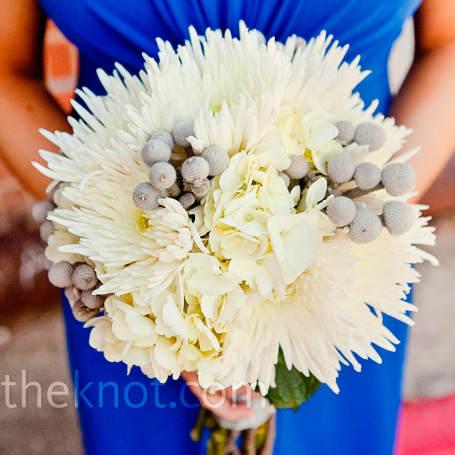 Spider mums, hydrangeas and berzelia berries gave the bridesmaid bouquets a full and textured look.