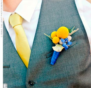 The guys boutonnieres were made up of craspedia, berzelia berries and stock.