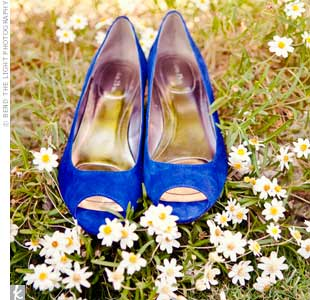 Kira found shoes in the perfect shade of cobalt blue to match the weddings color scheme.