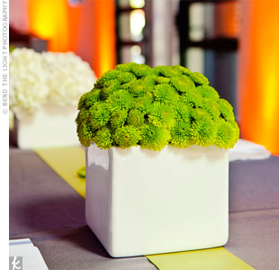 Each centerpiece vase held a compact arrangement of a different flower, including button mums, hydrangeas and spider mums.