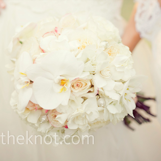 White peonies, garden roses and orchids with crystal and pearl accents made up Amy's dreamy bouquet.