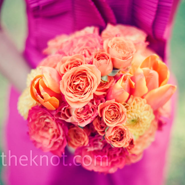 The girls carried lush bouquets of parrot tulips, antique roses and dahlias.