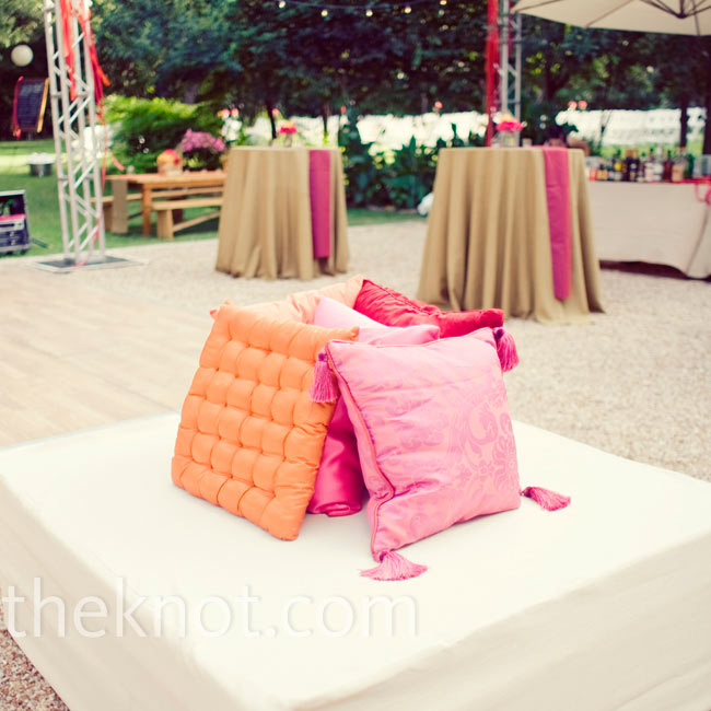 Sleek white ottomans and chic pillows gave Mercury Hall's outdoor area a mod, nightclub atmosphere.