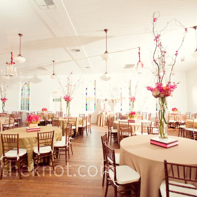 Burlap table linens and tall, hot-pink centerpieces set the rustic-yet-modern look Amy and Matt wanted.