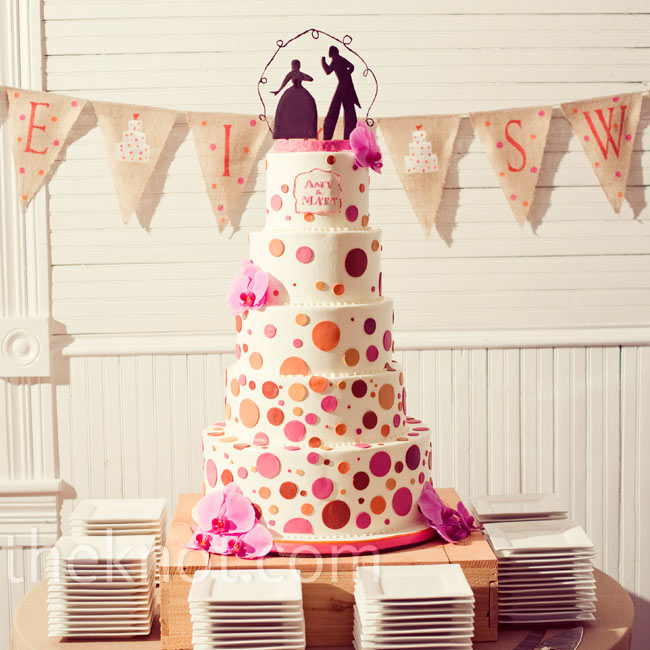 A silhouette topper made entirely out of chocolate topped this polka-dotted buttercream cake.
