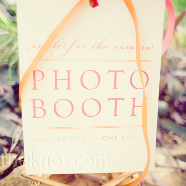 During the cocktail hour, guests took pictures in a photo booth decorated with old family photos strung along clotheslines.