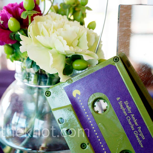The couple originally wanted cassette tapes for their invitations, but the postage proved to be too pricey. Instead, they used them as escort cards.