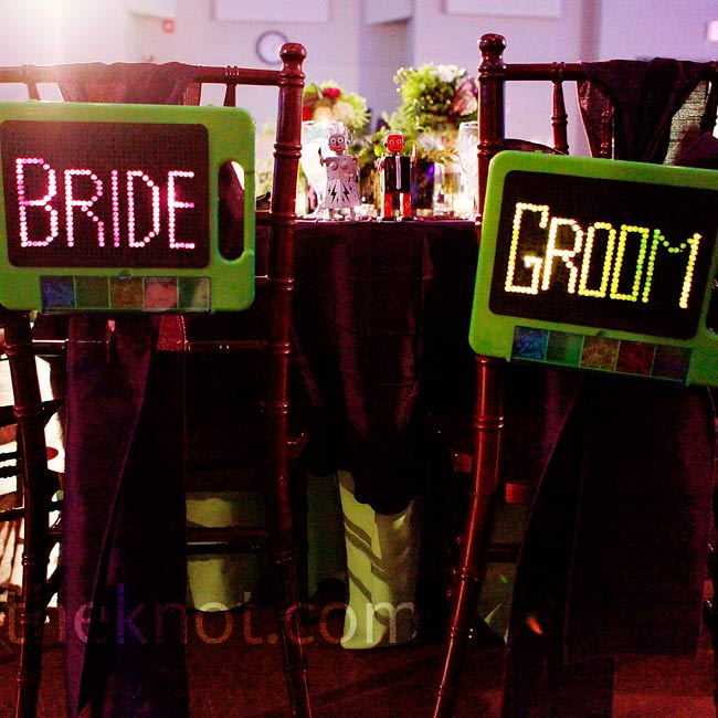 All of the wedding signage was made of Lite-Brites, including the bride and groom chair signs.