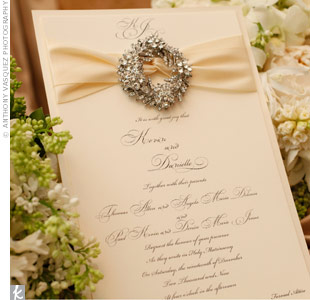 Taking traditional stationery to a whole new level, Danielle and Kevin added ribbons and jewel brooches to each invitation for a truly glamorous feel. Michael then incorporated similar jewel accents into other aspects of the decor, from the centerpieces to the cake.