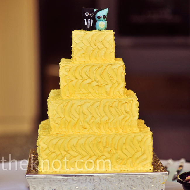 simple four tiered yellow cake let the quirky owl cake topper shine