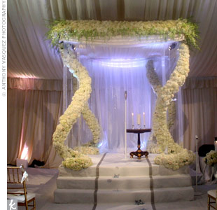 Michael wrapped white hydrangeas and roses around Lucite pillars to create an interesting illusion for Danielle Deleasa and Kevin Jonas' ceremony canopy.