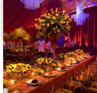Tall, extravagant centerpieces pack more of a punch when placed sporadically throughout the reception space, and low, full centerpieces at the tables allow guests to chat more easily.