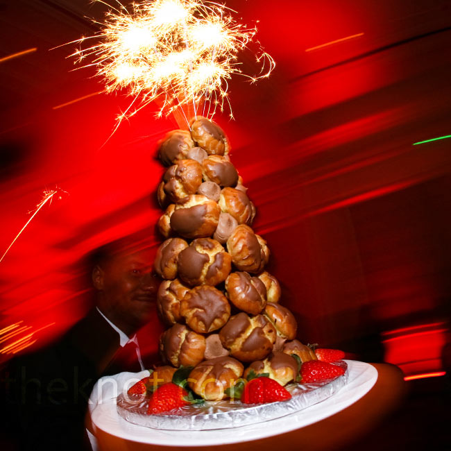Marcy is a big believer in incorporating surprises into the food you serve, like this tower of chocolate eclairs topped with sparklers. 