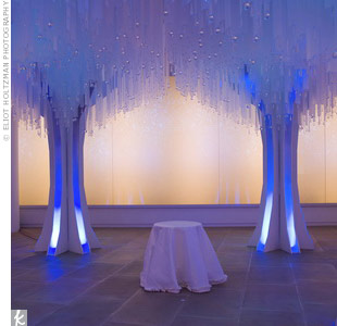 An ultra-modern take on the ceremony space, Marcy fashioned these LED-lit trees (which changed colors!) for a recent New York City wedding.