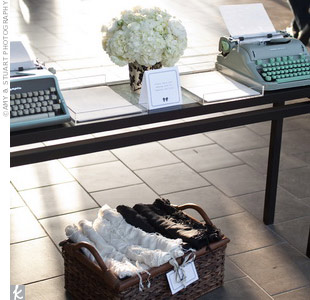 Because Colin's father, Tom Hanks, is an avid collector of antique typewriters, Marcy set out several from his collection for guests to type notes to the couple.